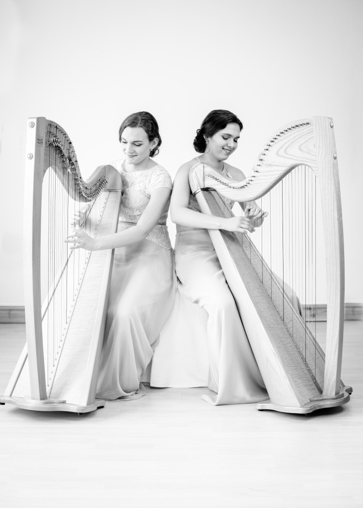 Sisters Adel and Karina wedding harpists, playing sis sting down, wedding dresses