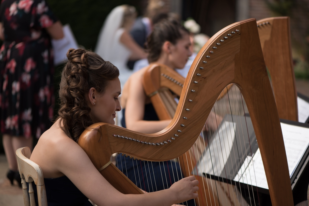 2 of Harps, harpists playing at an outdoor wedding at Port Lympne Hotel and Reserve in Kent