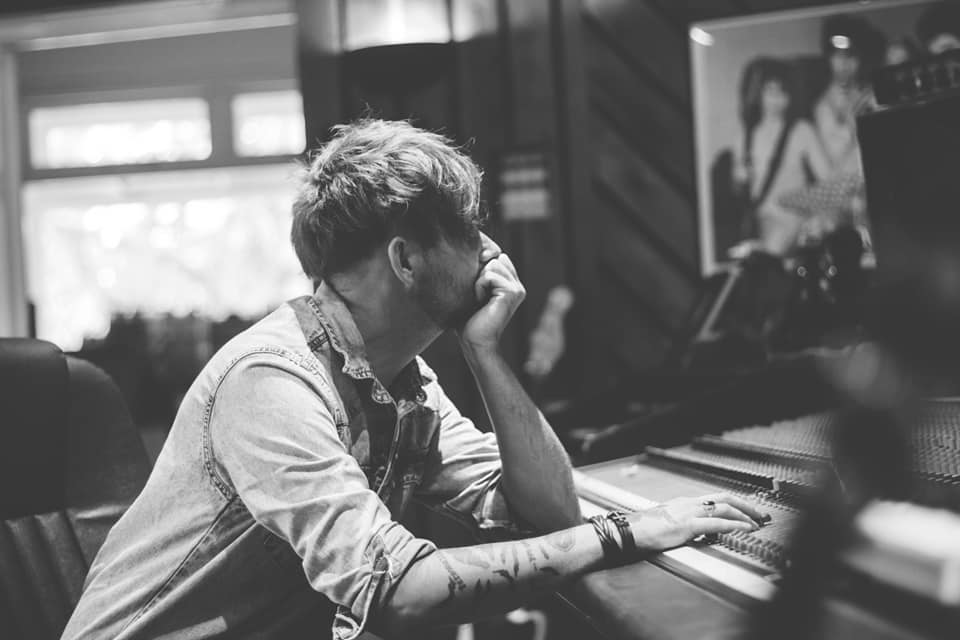 Sound producer and engineer Dan Lucas at Anchor Baby leaning on mixing desk, black and white