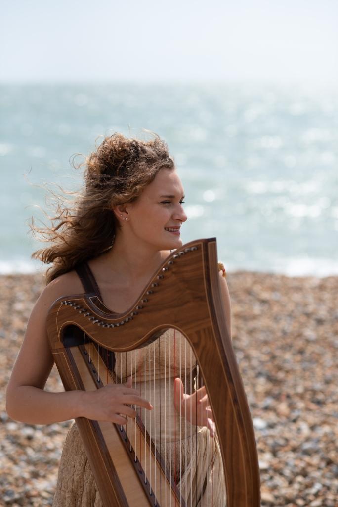 Karina Wilson professional harpist playing the harp on Sandgate beach Kent UK